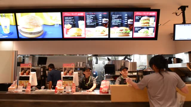 an illuminated menu is displayed above a service counter inside a mcdonald's restaurant operated by mcdonald's holdings co japan ltd in tokyo japan... - menu stock videos & royalty-free footage