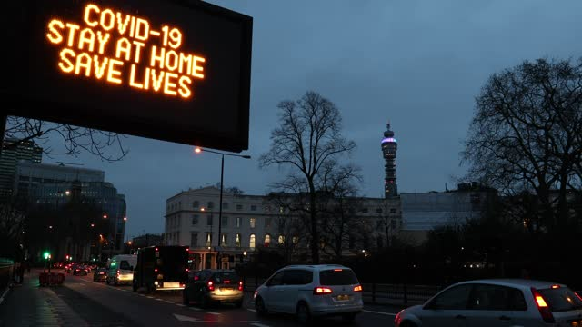 """an illuminated road sign, which reads """"covid-19 stay at home save lives"""" is seen on marylebone road along with traffic on february 9, 2021 in london,... - stay at home order stock videos & royalty-free footage"""