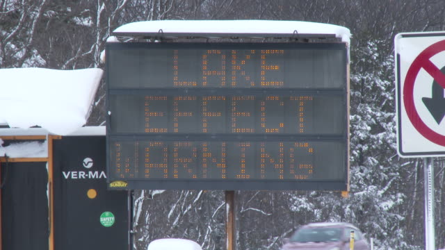 an illuminated traffic sign on interstate 81 in western ny warns drivers of impending blizzard conditions - warning sign stock videos & royalty-free footage