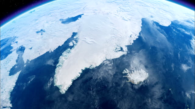 an image from space focuses on iceland and greenland. available in hd. - europa kontinent stock-videos und b-roll-filmmaterial