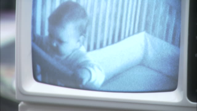 an image of baby girl in her crib is displayed on a small monitor. - new mexico stock videos & royalty-free footage