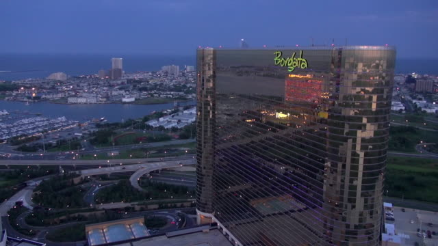 an image of the water club casino reflects on the glass facade of the nearby borgata casino in atlantic city's marina area. - atlantic city stock videos & royalty-free footage