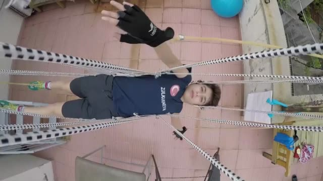 an imaginative father has constructed a swimming mechanism without needing water for his swimmer son to continue training during the coronavirus... - teenager stock videos & royalty-free footage