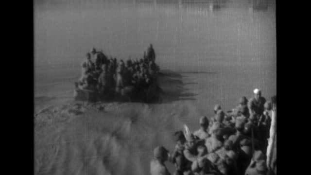 An Imperial Japanese Army artillery unit supports 38th Division soldiers as they cross the Yellow River and then advance inland where they use field...