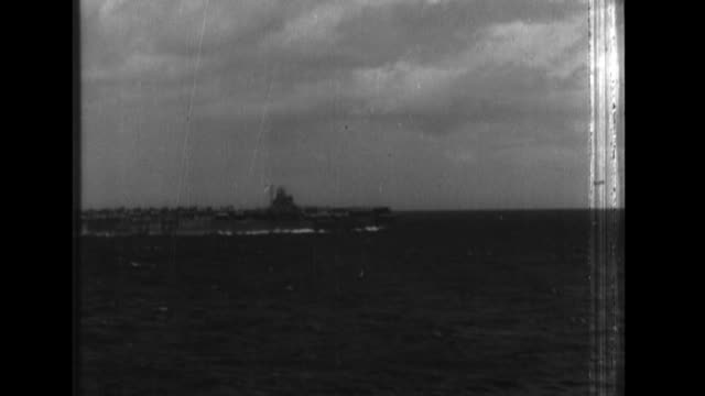 An Imperial Japanese Navy fleet launches aircraft from one of its aircraft carriers and then shoots down American aircraft as it engages in combat...