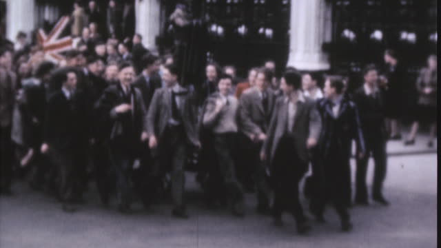 an impromptu of people carrying the union jack through the street on ve day / london, england, united kingdom - 1945 stock videos & royalty-free footage
