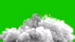 An increasing cloud of Smoke after a strong explosion and shockwave with green screen.
