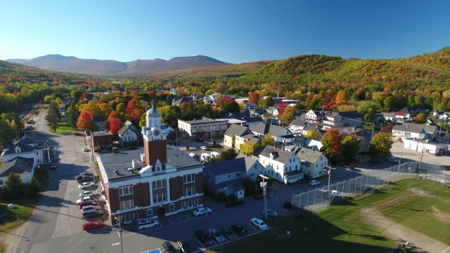 an incredible aerial view of the village of gorham, maine in autumn. maine. usa - small town stock videos & royalty-free footage