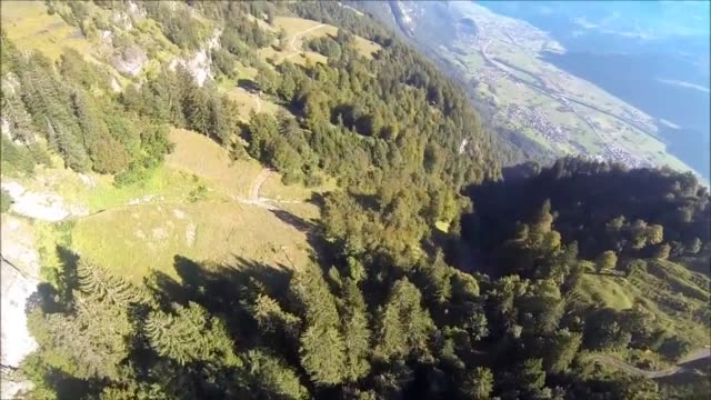 an incredible tree slalom wingsuit proximity flight over the left line off sputnik exit in walenstadt, switzerland. special thanks to nick, james y.,... - sputnik stock videos & royalty-free footage