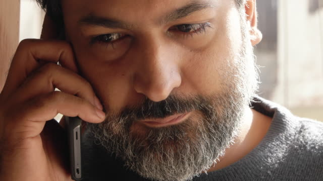 an indian man having a serious mobile phone conversation - worried stock videos & royalty-free footage