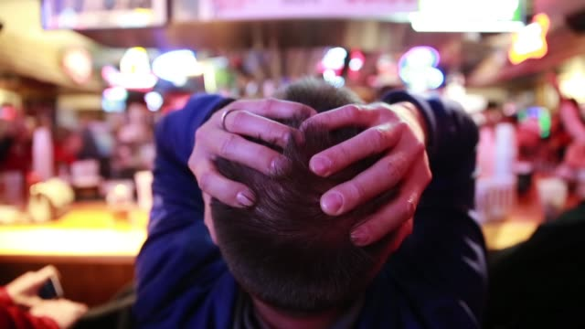 An Indiana University basketball fan shows his anxiety as he cheers for the Indiana University Hoosiers who are playing against against Kentucky...