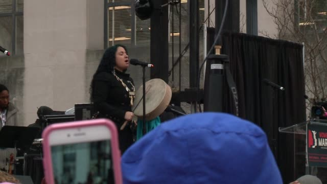 WGN An Indigenous Woman part of the group Indigenous Women Rise Sings a Song in a Native American Language at the Beginning of the Women's March in...