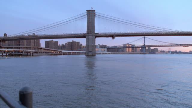 an indigo sky glows above the brooklyn bridge in new york city. - 2001 stock videos & royalty-free footage