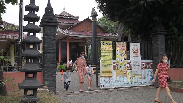 an indonesian buddhist leave out a temple after they pray during vesak day at indonesia theravada buddhist centre on may 26 in medan, indonesia.... - albert damanik stock videos & royalty-free footage
