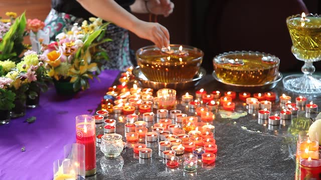 an indonesian buddhist lights candles during vesak day at indonesia theravada buddhist centre on may 26 in medan, indonesia. buddhists celebrated... - albert damanik stock videos & royalty-free footage