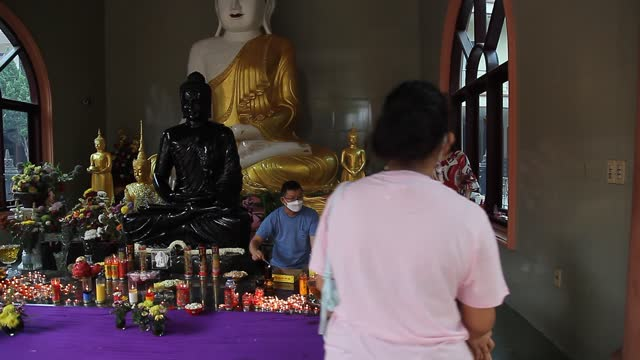 an indonesian buddhist prays during vesak day at indonesia theravada buddhist centre on may 26 in medan, indonesia. buddhists celebrated vesak day on... - albert damanik stock videos & royalty-free footage