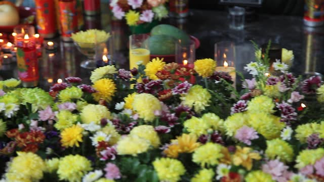 an indonesian buddhist put a candle during vesak day at indonesia theravada buddhist centre on may 26 in medan, indonesia. buddhists celebrated vesak... - albert damanik stock videos & royalty-free footage