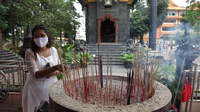 an indonesian buddhist put incense as they pray during vesak day at indonesia theravada buddhist centre on may 26 in medan, indonesia. buddhists... - albert damanik stock videos & royalty-free footage
