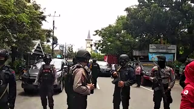 an indonesian cathedral was rocked by a suspected suicide bombing on sunday with body parts littering the chaotic scene as christians inside... - littering stock videos & royalty-free footage