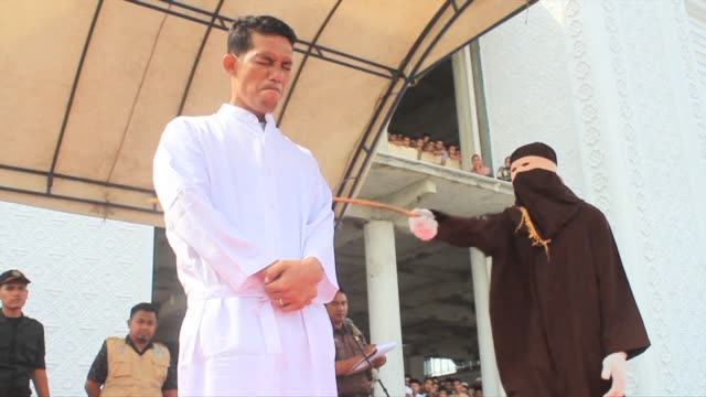 An Indonesian Christian is publicly flogged for selling alcohol in conservative Aceh province a violation of Islamic law as a crowd of onlookers...