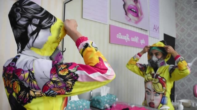 an indonesian dentist is trying to lift her patients' spirits with customised and colourful ppe suits which she creates herself - customised stock videos & royalty-free footage