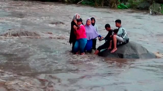 an indonesian family were trapped while taking amid river selfie near tanjungkenongo village of east java on march 06, 2017 in indonesia. they were... - photography themes stock videos & royalty-free footage