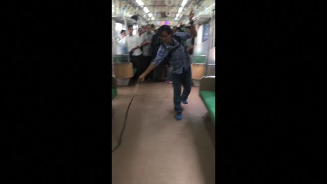an indonesian man has become an internet star after he was filmed using his bare hands to remove a snake from a busy commuter train on the island of... - star island stock videos & royalty-free footage