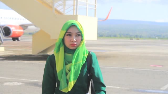 An Indonesian province is ordering Muslim female flight attendants landing in the region to don a hijab upon arrival or face punishment by religious...