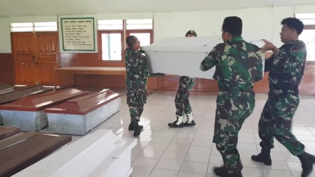an indonesian soldier was killed in a gun fight while investigating reports that more than two dozen construction workers were shot dead by... - separatism stock videos & royalty-free footage