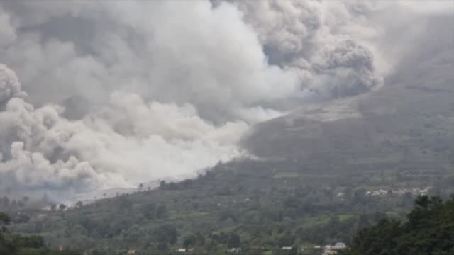 An Indonesian volcano erupts sending a massive column of ash and smoke some 5000 metres into the air leaving local villages coated in debris and...