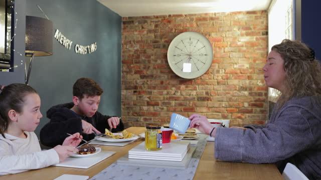 an indulgent breakfast on christmas morning - bathrobe stock videos & royalty-free footage