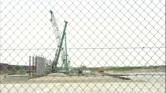 An industrial crane towers above a Niigata East Port construction site.