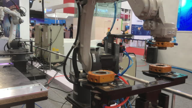 an industrial robot shows its skills on the 2nd world intelligence congress, which was held in tianjin meijiang exhibition center from may 16-18,... - machinery stock videos & royalty-free footage
