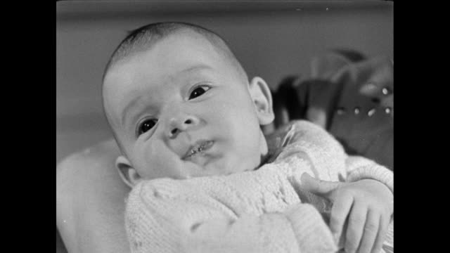 cu an infant sitting quietly / oxford, england, united kingdom - 1946 stock videos & royalty-free footage