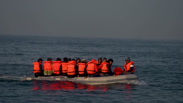 an inflatable craft carrying migrant men, women and children crosses the shipping lane in the english channel on july 22, 2021 off the coast of... - males stock videos & royalty-free footage