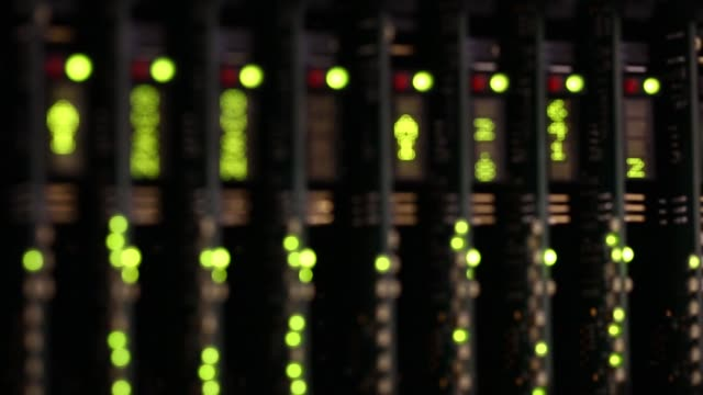 an information display flashes green in a server room in london, united kingdom on friday, 24th october pull focus of the display, lights flash next... - server room stock videos & royalty-free footage