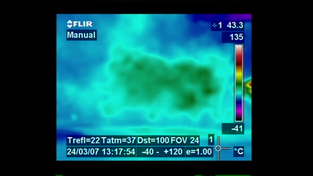 an infrared image depicts the release of steam as molten lava flows into the ocean. - dampf stock-videos und b-roll-filmmaterial