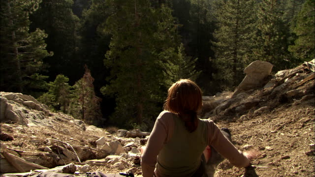 an injured hiker scoots herself along a rocky slope. - lost stock videos & royalty-free footage