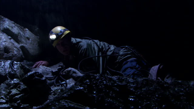 an injured  miner lies tangled in ropes. - injured stock videos & royalty-free footage
