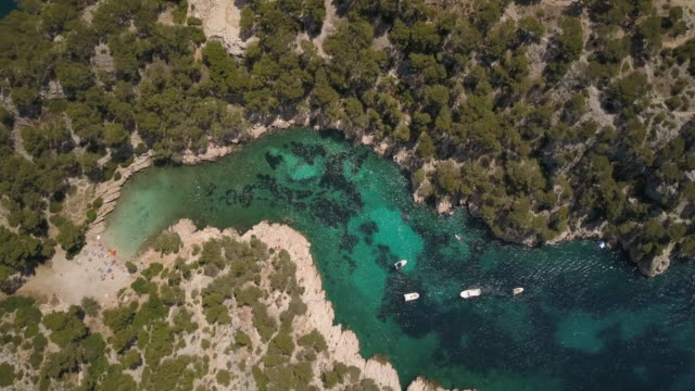 an inlet near cassis harbour on the south coast of france with swimmers - inlet stock videos & royalty-free footage
