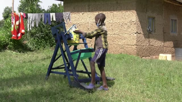 an innovative nineyearold from western kenya has designed a machine that allows people to wash their hands by using a foot pedal and therefore... - innovation stock videos & royalty-free footage