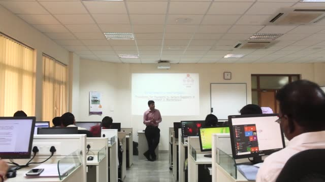 an instructor talks to trainees about using the government e marketplace website during a class at the national institute of financial management in... - haryana stock videos & royalty-free footage