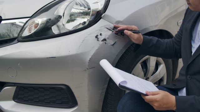 an insurance agent inspect a car. - road accident stock videos & royalty-free footage