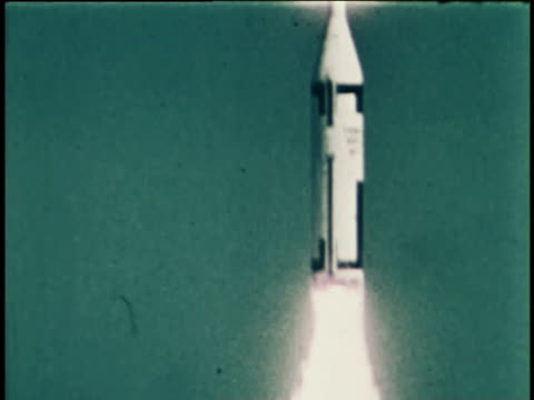 an intercontinental ballistic missile erupts from the ocean, launched from a nuclear submarine. - guerra fredda video stock e b–roll