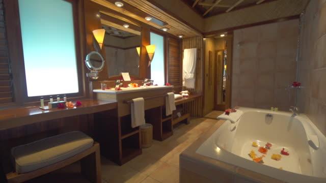 an interior luxury resort hotel bathroom. - bathroom stock videos & royalty-free footage