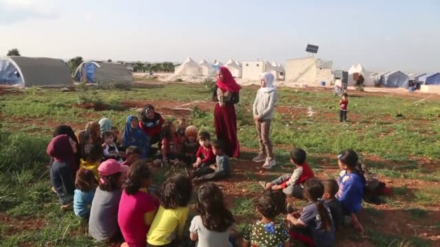 an internally displaced 11-year-old syrian girl is helping educate younger children whose schools have been closed and are unable to follow distance... - girls stock videos & royalty-free footage