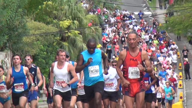 an international field heads to bermuda for a fun filler race weekend with all the trimmings runners in 10k right after start head up hill - bermuda stock videos & royalty-free footage