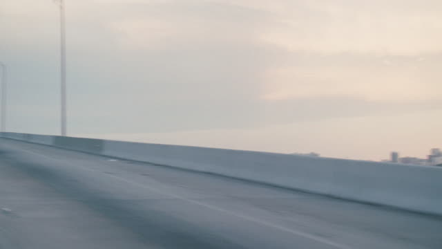 an interstate runs along the biscayne bay and into miami, florida. - car point of view stock videos & royalty-free footage
