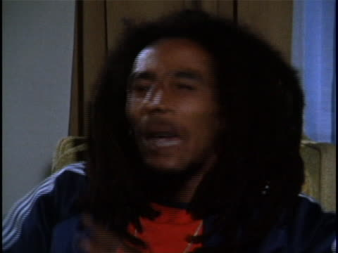 an interview with reggae musician and activist, bab marley. during the interview he comments about the recent attempt made on his life. he says,... - bob marley musician点の映像素材/bロール