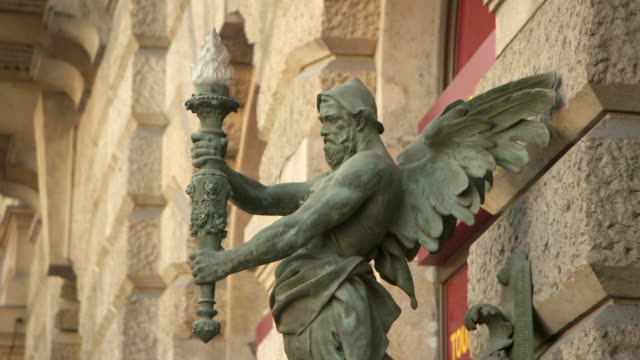an intricate bronze lighting sconce in the shape of a winged man on a wall - gothic stock videos & royalty-free footage